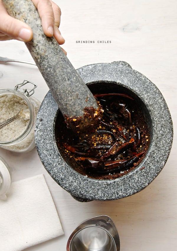 Salsa-Roja-Asada_grinding-chiles